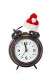 Horloge avec le chapeau de Noël Photographie stock libre de droits
