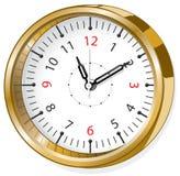 Horloge brillante d'or Photographie stock libre de droits