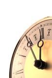 Horloge démodée d'or d'isolement sur le blanc Photographie stock