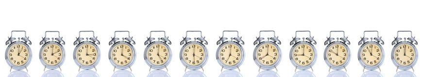 Horloge d'alarme avec l'horloge des périodes 12 Photographie stock
