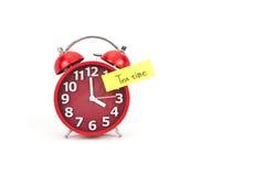 Horloge d'alarme avec une note Images stock