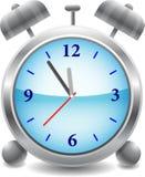 Horloge d'alarme bleue Photographie stock libre de droits