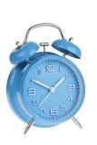 Horloge d'alarme bleue d'isolement sur le blanc Photos libres de droits
