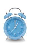 Horloge d'alarme bleue d'isolement sur le blanc Photos stock