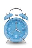 Horloge d'alarme bleue d'isolement sur le blanc Images stock