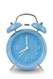 Horloge d'alarme bleue d'isolement sur le blanc Photo stock