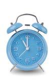 Horloge d'alarme bleue d'isolement sur le blanc Images libres de droits