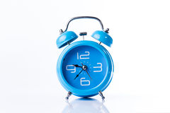 Horloge d'alarme bleue de vieux type Photo stock