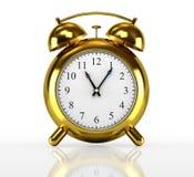 Horloge d'alarme d'or Photographie stock libre de droits