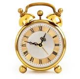 Horloge d'alarme d'or images stock