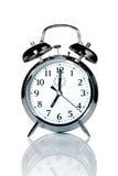 Horloge d'alarme d'isolement sur le blanc Photos stock