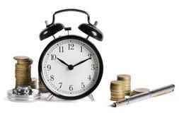Horloge d'alarme et argent Photos stock