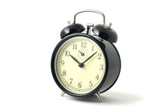 Horloge d'alarme noire de cru Photo libre de droits
