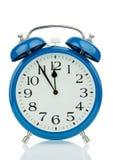 Horloge d'alarme sur le fond blanc Photo stock