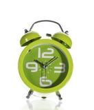 Horloge d'alarme verte sur le fond blanc Photographie stock