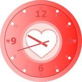Horloge d'amour avec en forme de coeur dans la plaque de cadran.   Photos stock