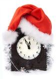Horloge dans le chapeau de christmass Photographie stock