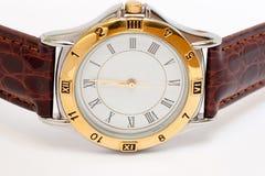 Horloge dat over wit wordt geïsoleerdd Stock Foto
