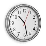 Horloge de bureau sur le mur Photos libres de droits