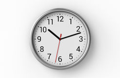 Horloge de bureau sur le mur blanc Images libres de droits