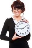 Horloge de fixation de femme d'affaires Image stock