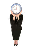 Horloge de fixation de femme d'affaires Image stock