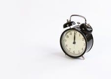 Horloge de table classique sur un fond blanc Image libre de droits