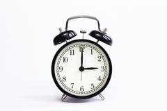 Horloge de table classique sur un fond blanc Images libres de droits
