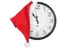 Horloge de vintage avec le chapeau de Santa de Noël Photo stock