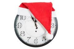 Horloge de vintage avec le chapeau de Santa de Noël Image libre de droits