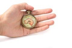Horloge de vintage disponible Photographie stock