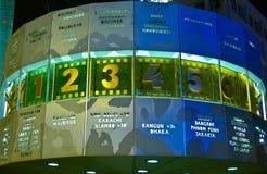Horloge du monde par nuit Images stock