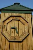 Horloge en bois Photographie stock libre de droits