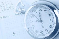 Horloge en kalender stock foto