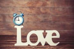 Horloge et amour de mot Photographie stock libre de droits