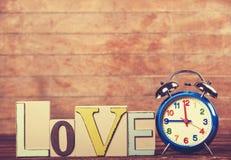 Horloge et amour de mot Image libre de droits