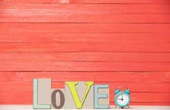 Horloge et amour de mot Photos stock