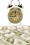 Horloge et argent Images stock