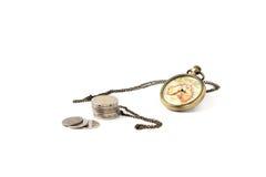Horloge et argent de vintage Images stock