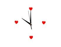 Horloge et coeurs d'abrégé sur jour du ` s de Valentine Photographie stock libre de droits