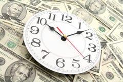 Horloge et dollars de mur Photo libre de droits