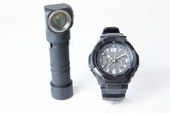 Horloge et lampe-torche militaires Photographie stock libre de droits