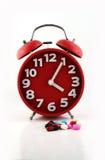 Horloge et pilules, pour des soins de santé, Photos libres de droits
