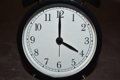 Horloge indiquant différentes périodes image stock