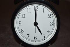 Horloge indiquant différentes périodes photographie stock