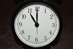 Horloge indiquant différentes périodes photos stock