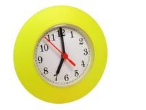 Horloge jaune d'isolement photos stock