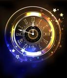 Horloge lumineuse avec des étoiles Photographie stock