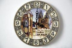 Horloge murale avec des images des points de repère Photographie stock