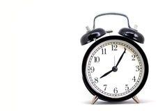 Horloge noire de vintage, huit heures 5 minutes Image libre de droits